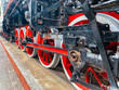 brake system iron wheels of stream engine locomotive train on railways track forward use for old and classic period land transport and retro vintage style background