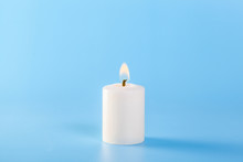 White Candles On A Blue Backgr...