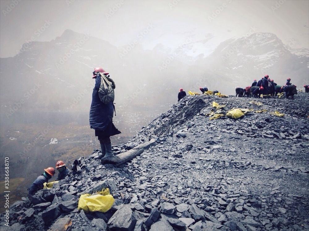 Fototapeta Miners Standing On Edge