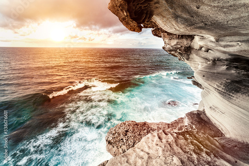 Wonderful sunset over the sea with waves. Amazing view from the rocky coast at Bondi Beach in Sydney Australia. - 338676601