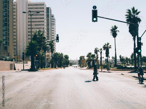 Fotografie, Obraz City Street And Buildings Against Clear Sky