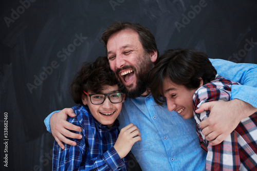 Obraz na płótnie happy father hugging sons