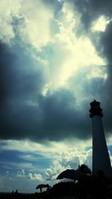 Silhouette Of Lighthouse Against Dramatic Sky