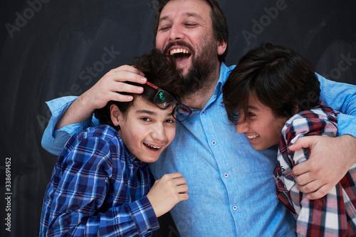 Fotografie, Obraz happy father hugging sons