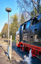 Steam Train At A Train Station...