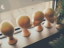 High Angle View Of Mannequin Busts In Store Display
