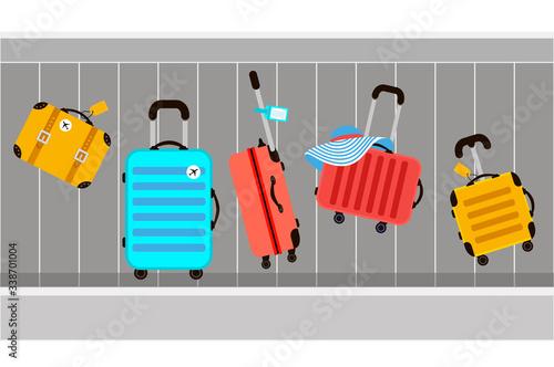 Obraz na plátně Suitcases on airport luggage conveyor belt