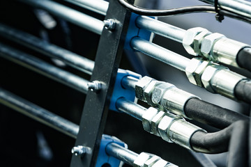 Pipe system of hydraulic valves in agricultural machinery