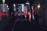 People On Illuminated Street At Night In City