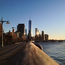 One World Trade Center By River Against Clear Blue Sky