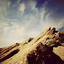 Low Angle View Of Vasquez Rocks Against Cloudy Sky
