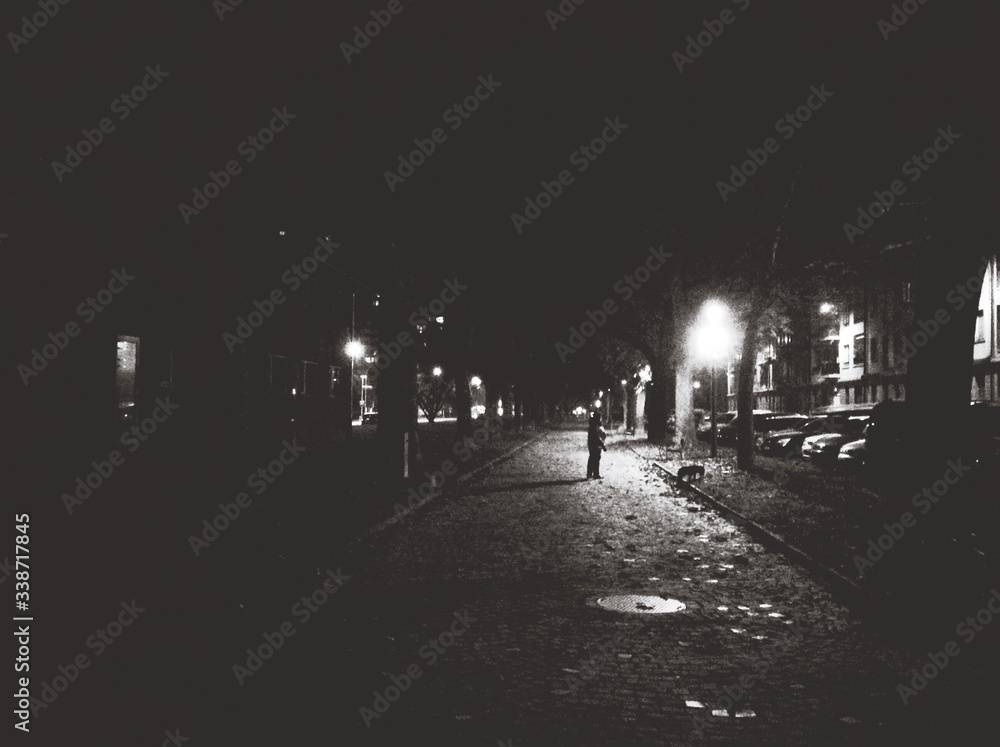 Man Standing On Road In The Dark