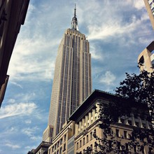 Low Angle View Of Empire State Building Against Sky
