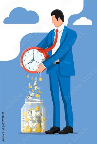 Cuadros en Lienzo Glass money jar, gold coins banknotes falling from clocks