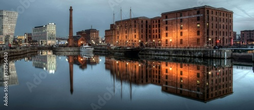 Reflection Of City In Calm River At Dusk - fototapety na wymiar