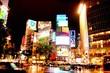 Leinwandbild Motiv Low Angle View Of Illuminated Shibuya Station At Night In City
