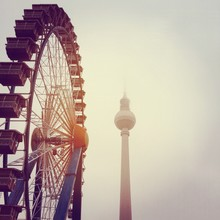 Low Angle View Of Ferris Wheel By Fernsehturm Against Clear Sky
