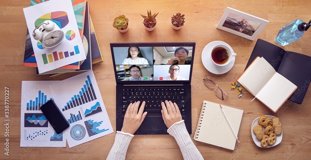 Fototapeta work from home. people make video conference with multi colleague via laptop computer during self isolation to avoid spreading illness transmission of COVID-19 Coronavirus outbreak. Social distancing