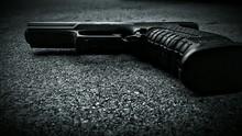 Close-up Of Gun On The Ground