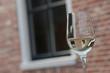 Glass of white wine. Restaurant. Reflections.