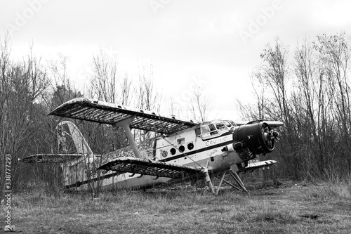 Fotografie, Obraz Old destroyed Soviet abandoned military airplanes in the field in Ukraine, black