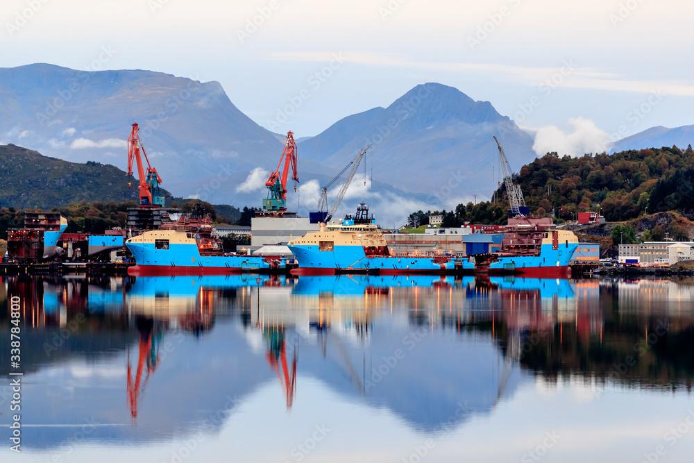 Fototapeta ULSTEINVIK, NORWAY - 2017 SEPTEMBER 18. Modern offshore vessels being built at shipyard Kleven Yard.