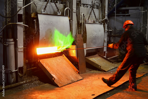 Steel quenching at high temperature in industrial furnace at the workshop of a forge plant Fototapeta