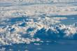 Leinwandbild Motiv Flying Above the Clouds - Looking through the airplane window