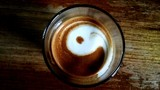 Directly Above Shot Of Coffee With Yin Yang Symbol