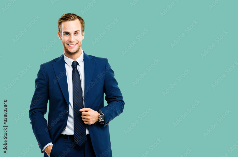 Fototapeta Portrait of happy confident businessman in blue suit and tie, isolated over green marine color background. Business success concept. Smiling man at studio picture. Copy space for some text or slogan.