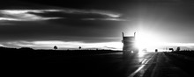 Silhouette Truck On Highway Against Cloudy Sky During Sunset