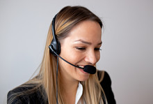 Young Woman Working In Call Ce...