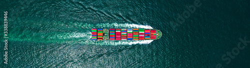 Carta da parati Aerial view container cargo ship in ocean, Business industry commerce global import export logistic transportation oversea worldwide, Sea shipping company vessel, copy space for web banner