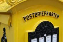 Close-up Of Yellow Mailbox