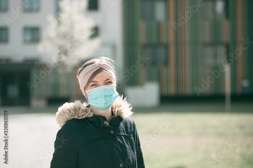 Fototapety, obrazy: Flue and corona safety concept. Woman wearing face mask to protect herself, outdoors