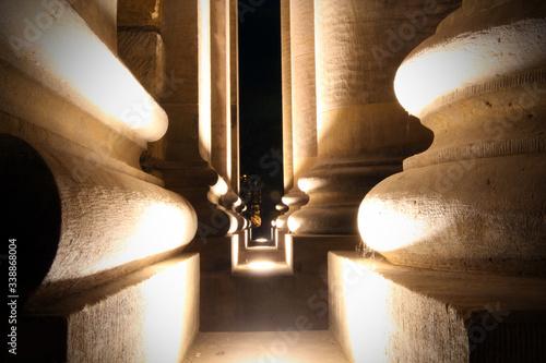 Footpath Amidst Illuminated Historic Building At Night - fototapety na wymiar