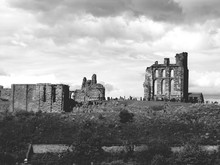 Remains Of Tynemouth Castle And Priory Against Cloudy Sky