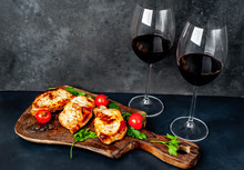 Dinner For Two, Grilled Pork Steaks With Spices, Glasses With Red  Wine On Stone Background