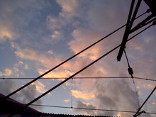 Power Lines Against Cloudy Sky
