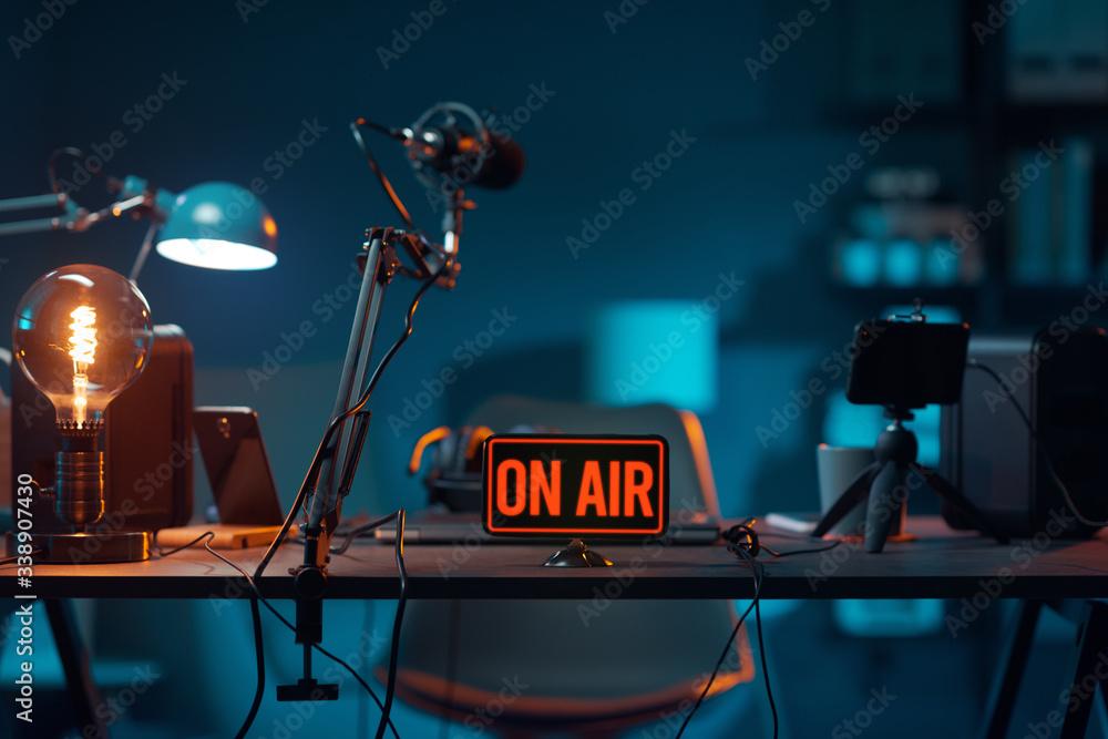 Fototapeta Live online radio studio with on air sign
