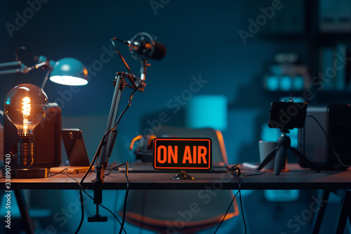 Live online radio studio with on air sign