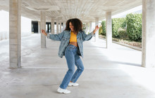 Smiling Woman Dancing In An Empty Parking
