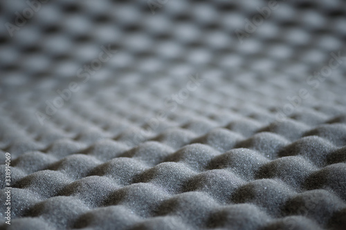 Valokuvatapetti Abstract wavy texture of grey soundproof acoustic foam with selective focus and
