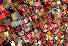 Full Frame Shot Of Love Padlocks Hanging On Fence