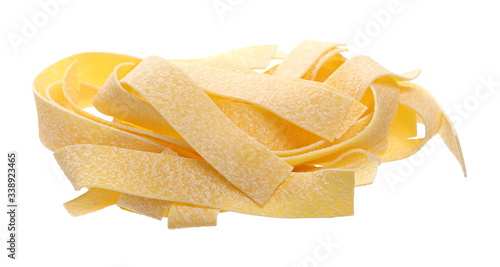 Fototapeta Raw pasta, pappardelle isolated on white background, clipping path obraz