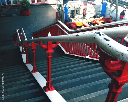 Vászonkép Staircase With Red Bannisters At Railroad Station