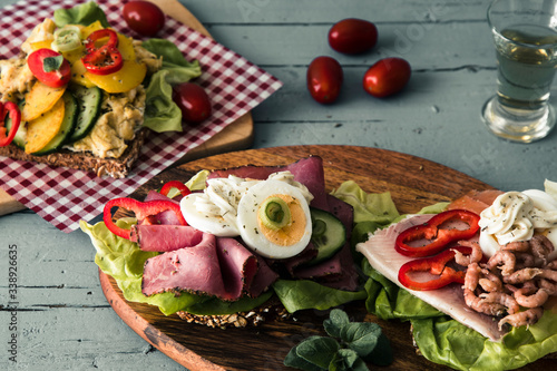 Variety of danish open sandwiches on wooden boards Canvas Print