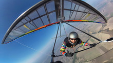 Smiling Hang Glider Pilot Show...