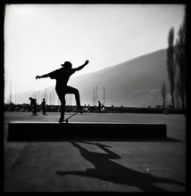 Silhouette Of Man Jumping On Skateboard