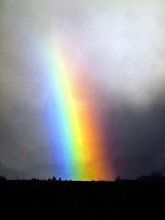 Scenic View Of Rainbow Against Cloudy Sky At Dusk